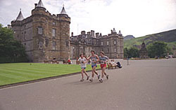 IMage of runners in the grounds of Holyrood Palace